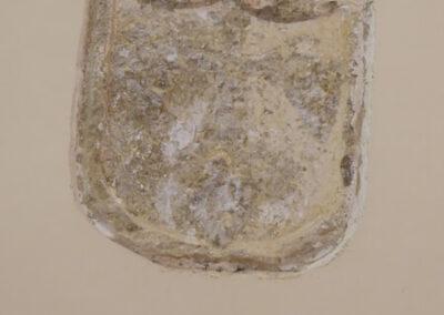Escudo incrustado en uno de los muros de la iglesia