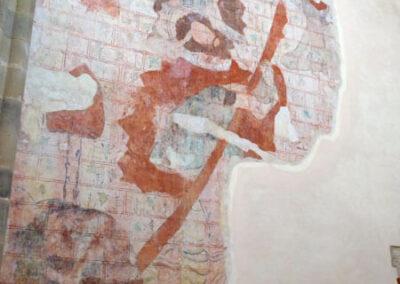 Pintura mural que representa a San Cristóbal con el niño a hombros